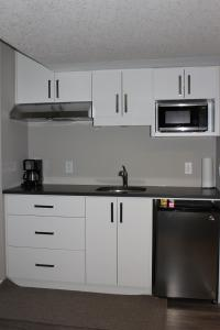 A kitchen or kitchenette at Boardwalk Homes Vacation & Bridal Guest Houses