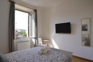 A bed or beds in a room at Livia B&B - Trastevere