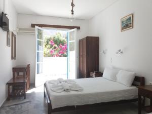 Un ou plusieurs lits dans un hébergement de l'établissement Bizas Rooms