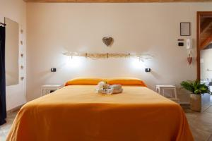 A bed or beds in a room at Le Quattro Stelle Affittacamere