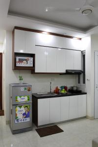 A kitchen or kitchenette at ISTAY Hotel Apartment 2