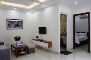 A television and/or entertainment center at ISTAY Hotel Apartment 2