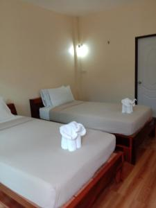 A bed or beds in a room at Prik Thai Resort