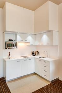 A kitchen or kitchenette at Mantra Charles Hotel