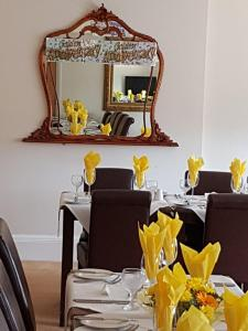 A restaurant or other place to eat at Rustington Manor Hotel