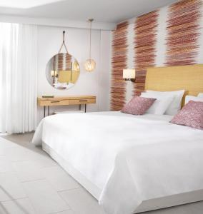 Кровать или кровати в номере Agapi Beach Resort Premium All Inclusive