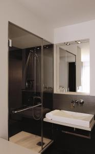 Ein Badezimmer in der Unterkunft Hotel AMANO Rooms & Apartments