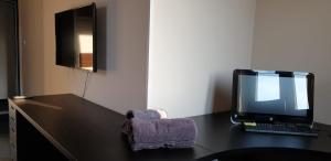 TV a/nebo společenská místnost v ubytování Duplex 3+kk
