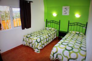 A bed or beds in a room at Aparthotel la Piramide