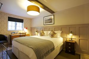 A bed or beds in a room at Bourne Valley Inn