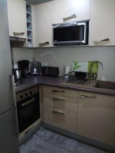 A kitchen or kitchenette at Mareinol Pacific