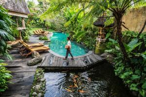 A view of the pool at Amatara Arya Ubud or nearby
