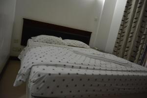 Florida Executive Innにあるベッド