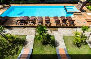 A view of the pool at Sleep In Lanta Resort or nearby