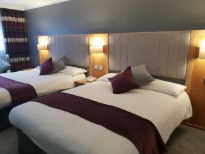 A bed or beds in a room at Best Western Diplomat Hotel and Spa