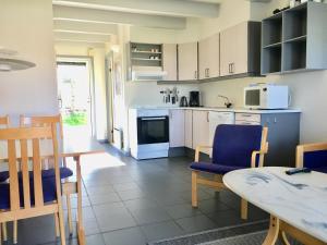 Køkken eller tekøkken på Feriecenter & Vandland Øster Hurup