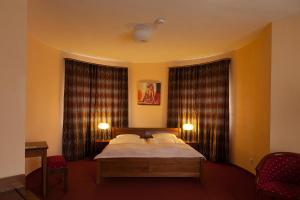 Postel nebo postele na pokoji v ubytování Villa Golf