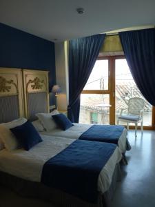 Cama o camas de una habitación en Los Calaos de Briones