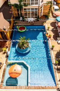 Вид на бассейн в Жемчуг Village Мини-отель или окрестностях