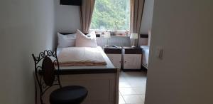 Ein Bett oder Betten in einem Zimmer der Unterkunft Hotel Elfenmühle
