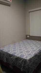 A bed or beds in a room at Residencial Jardim Europa