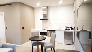 A kitchen or kitchenette at The Sebel Auckland Manukau