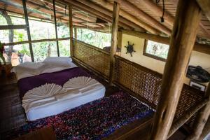 A bed or beds in a room at Paraty Paradiso