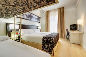 A bed or beds in a room at Sercotel Las Torres