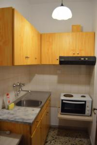 A kitchen or kitchenette at Eva Apartments
