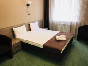 Кровать или кровати в номере Отель ГагарInn