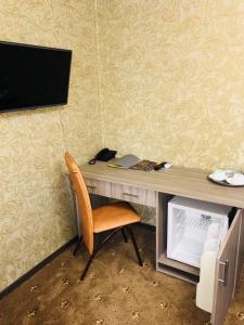 Телевизор и/или развлекательный центр в Отель ГагарInn