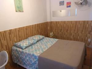 Cama ou camas em um quarto em Kitchenette Charmosa no Itagua