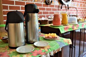 Breakfast options available to guests at Pousada do Imperador