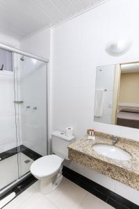 A bathroom at Hotel Express Savoy