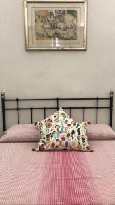 Un ou plusieurs lits dans un hébergement de l'établissement Santacroce Guest House