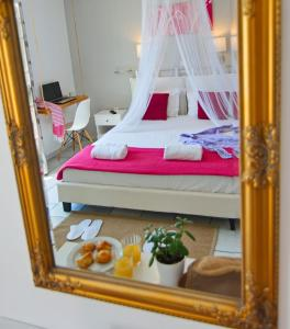 A bed or beds in a room at Camara Hotel