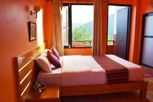 A bed or beds in a room at Siddhartha Garden Ayurveda