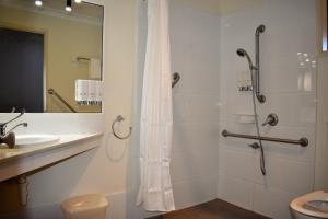 A bathroom at Best Western Tuscany on Tor Motor Inn