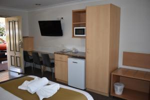 A television and/or entertainment center at Best Western Tuscany on Tor Motor Inn