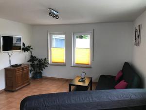 Ein Sitzbereich in der Unterkunft Ferienwohnung Heinerland