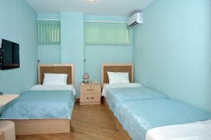Cama ou camas em um quarto em Flamingo Hotel Baku