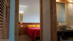 A bed or beds in a room at Casa Cavoquinho