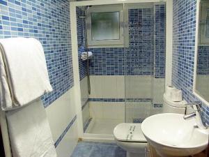 Un baño de Auto Check In Hotel Las Nieves
