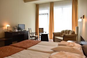 Кровать или кровати в номере Hotel *** NAT Ustroń