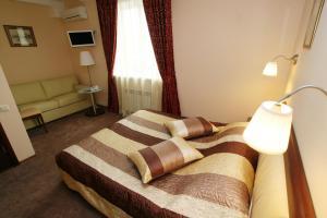 Кровать или кровати в номере Граф Отель
