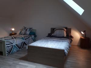 Un ou plusieurs lits dans un hébergement de l'établissement Belle Fleur
