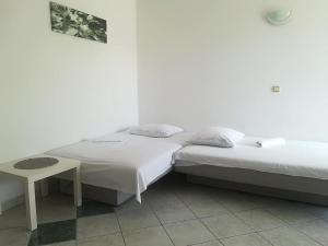 Krevet ili kreveti u jedinici u objektu Apartments Vlaovic