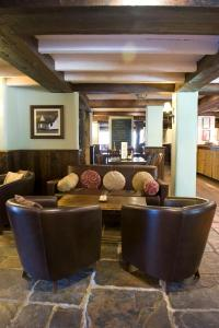 The lobby or reception area at Old Mill Hotel by Greene King Inns