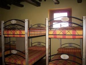 A bunk bed or bunk beds in a room at Albergue Estrella Del Camino