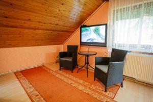 A seating area at Visegrád Vendégház-Apartman